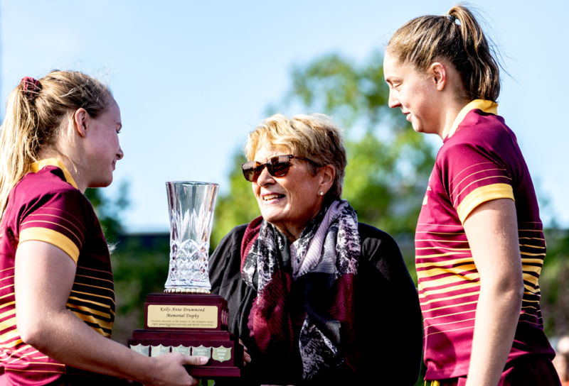 Doreen Haddad, Kelly-Anne Drummond's mother hands cup to Stingers captain. - Photo: Kieron Yates